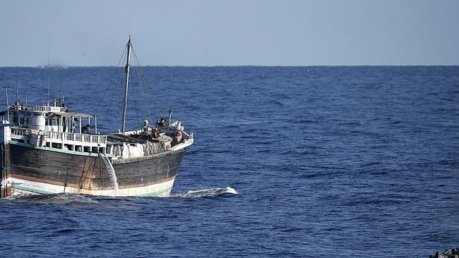 HMAS Darwin's rigged hull inflatable boats approach a suspicious vessel. Picture: ADF