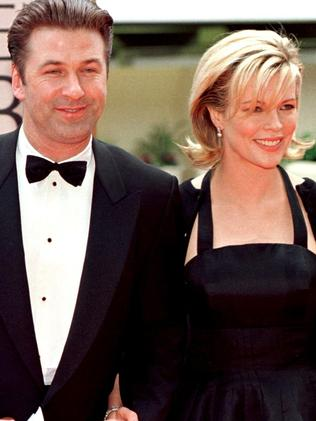 Kim Basinger (R) arrives with her then-husband actor Alec Baldwin. Picture: AFP