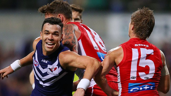Pressure ... Ryan Crowley leads the Fremantle attack on the opposition.