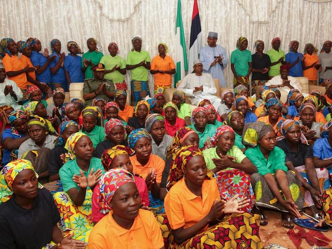 Nigeria's President Muhammadu Buhari with the 82 rescued Chibok girls during a reception at the Presidential Villa in Abuja, on May 7, 2017. Picture: AFP