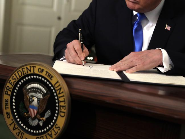 Donald Trump signs a proclamation to recognie Jerusalem as the capital of Israel. Picture: AP/Evan Vucci