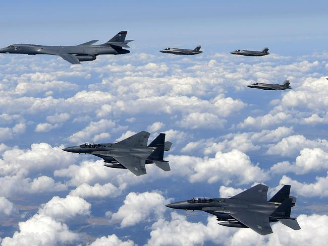 The US flew four stealth fighter jets and two bombers over the Korean peninsula in a show of force after North Korea's latest nuclear and missile tests. Picture: South Korean Defence Ministry/AFP