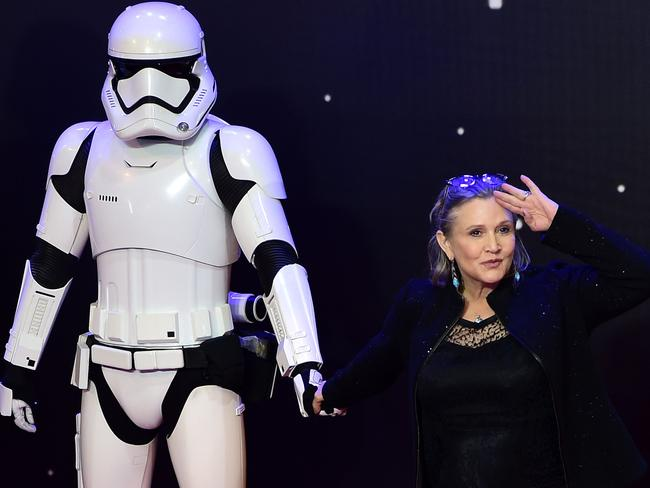Carrie Fisher posing with a storm trooper at the European Premiere of 