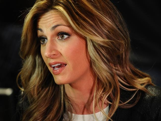 Erin Andrews answers questions from the media.