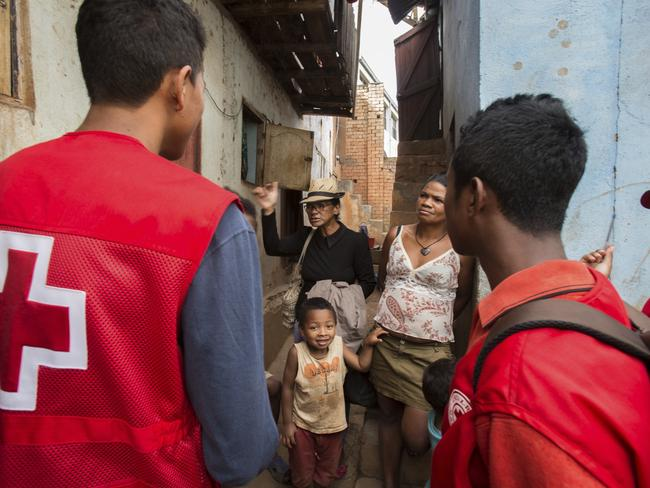 Red Cross volunteers talk to villagers about the plague as public gatherings are banned due to the outbreak. Picture: AP/Alexander Joe