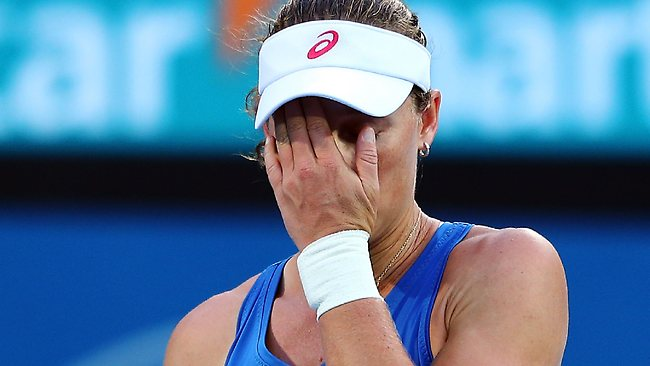 Samantha Stosur puts her hand in her face after losing a crucial point against Jie Zheng in Sydney.