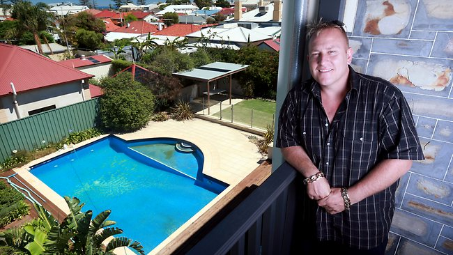 X Lotto winner Nick Marinis at his new Semaphore home that was previously owned by Matthew Primus. Picture: Calum Robertson