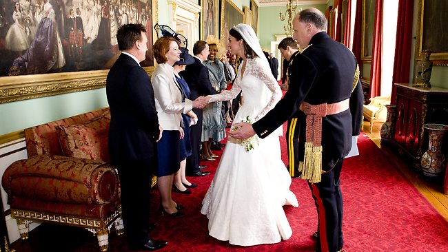 G'day, your Highness: Julia Gillard and Tim Matheison greet Kate at Buckingham Palace. Picture: Getty Images