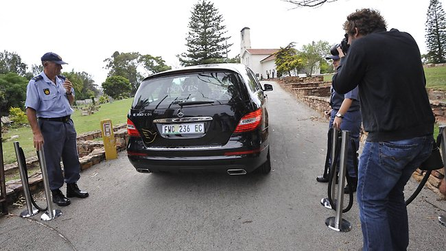 "The hearse with the coffin of the late South African model Reeva Steenkamp arrives for the funeral ceremony at the crematorium building in Port Elizabeth on February 19, 2013 after Steenkamp, 29, was shot four times in the early hours of February 14, 2013 by a 9mm pistol owned by South African sporting hero Oscar Pistorius. South African prosecutors on Tuesday told a bail hearing that Oscar Pistorius was guilty of ""premeditated murder"" in the Valentine's Day killing of his model girlfriend at his upscale home. AFP PHOTO / ALEXANDER JOE"