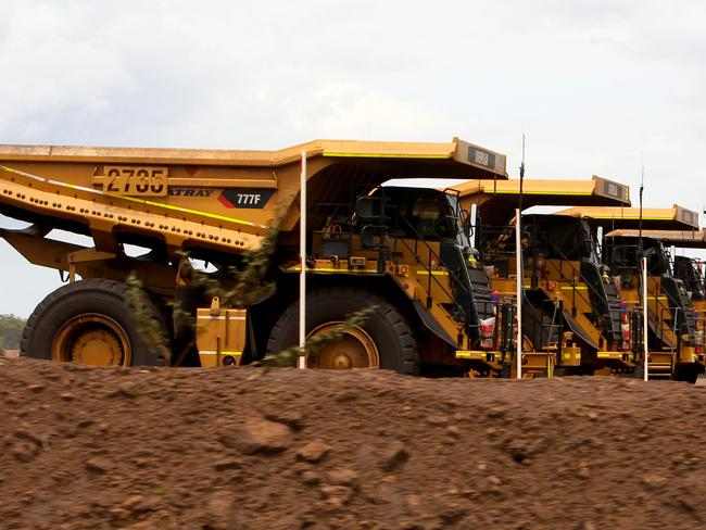 Giant trucks at the BHP Billiton/ GEMCO Groote Eylandt Manganese mine.