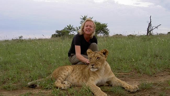 Fran getting close and personal with a lioness. Picture: Supplied