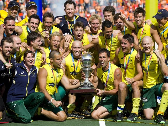 The Australian team celebrates with its trophy winning their men's Field Hockey World Cup final against the Netherlands.