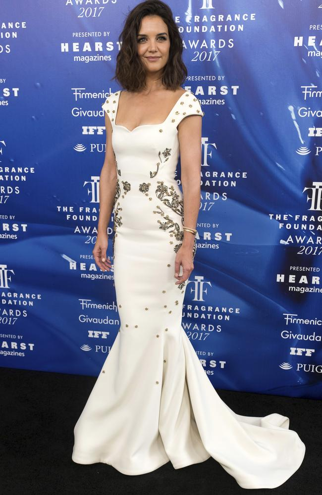 The actress stands out in the white figure-hugging Zac Posen gown.
