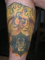<p>A reader shows his tattoo, which he describes as celebrating 35 years with the CFS.</p>