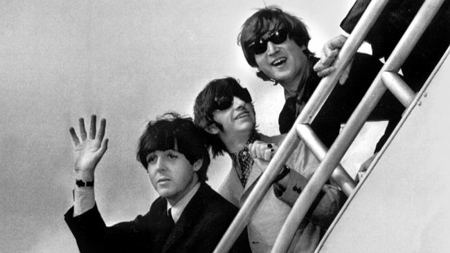 Paul McCartney, Ringo Starr and John Lennon at a New York airport. Photo: AP