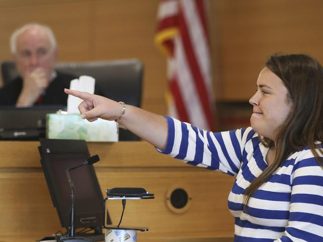 Camdyn Roy, the sister Conrad Roy III, points to the defendant Michelle Carter to identify her while testifying in Carter's trial. Picture: AP