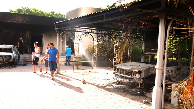 Libyans walk on the grounds of the gutted US consulate in Benghazi, Libya, after an attack that killed four Americans, including Ambassador Chris Stevens.