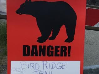 A sign warns people that the trail head is closed on Monday, June 19, 2017, after a fatal bear mauling at Bird Ridge Trail in Anchorage, Alaska. Authorities say a black bear killed a 16-year-old runner while he was competing in an Alaska race on Sunday. (AP Photo/Mark Thiessen)