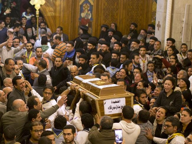 Relatives of Coptic Christians grieve as they carry the coffin of Nermin Sadek, one of the victims of the attack. Picture: AP Photo/Amr Nabil
