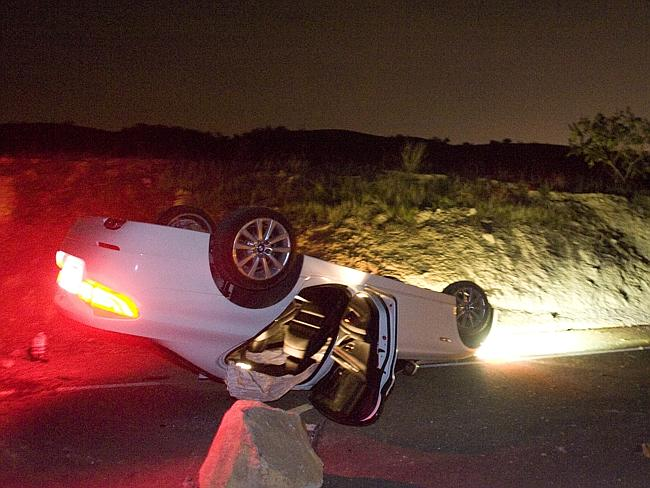 Earthquake ... a car that rolled over during strong earthquake in Los Angeles. Picture: A