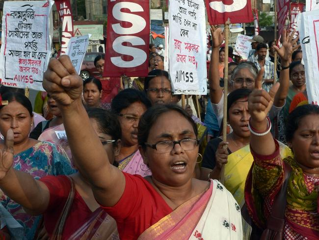 Indian activists from the Social Unity Center of India (SUCI) shout slogans against the state government in protest against the gang-rape and murder of two girls in the district of Badaun in the northern state of Uttar Pradesh and recent rapes in the eastern state of West Bengal, in Kolkata on June 7, 2014.