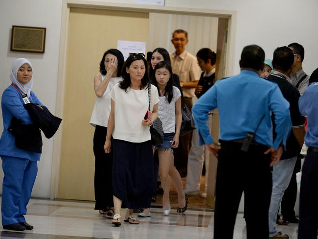 Wanting answers ... next of kin of passengers on-board the ill fated Malaysia Airlines, MH17, walk out after briefing before their DNA and blood samples were taken at a hotel in Putrajaya outside Kuala Lumpur, Malaysia. Picture: Joshua Paul