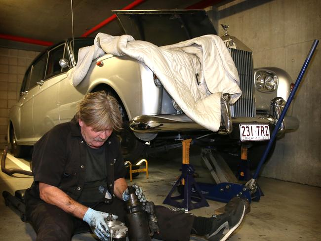 Technical difficulties ... Clive Palmer's Rolls Royce being fixed by Eric the Mechanic in Parliament House Car park in Canberra.