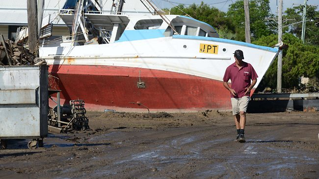 FLOOD: A trawler sits high & dry in Quay Street, Bundaberg, after the flood. Picture: Paul Buetel