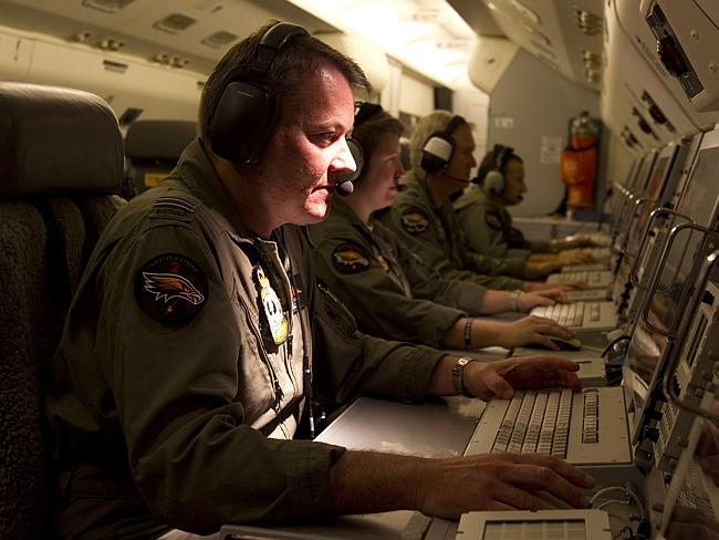 Looking ... Flight Lieutenant Phil Wade mans the Mission Commander station aboard the RAA