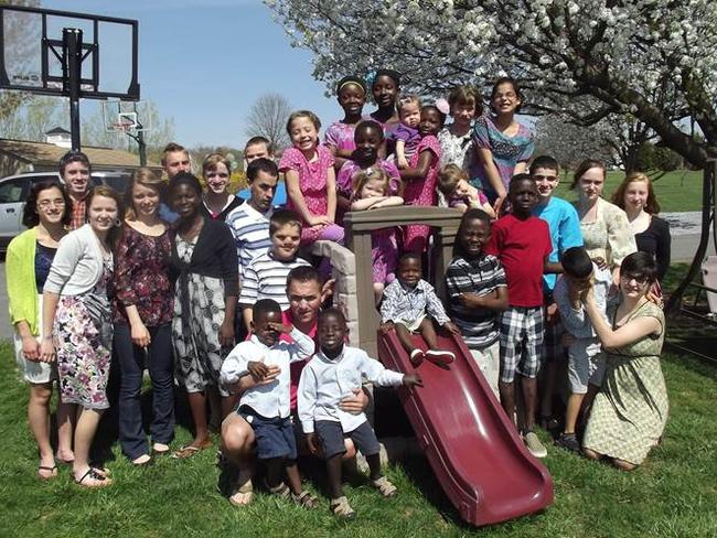 Loving family ... the Briggs have adopted 29 children from around the world, with some pictured here. Picture: Courtesy of Jeane Briggs