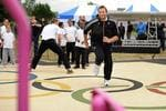 <p>Australian swimmer and five-time Olympic champion, Ian Thorpe exercises with local school children during a visit to an AdiZone in east London, on May 11, 2011. The multi-sport outdoor venue is free to use for the local community and was inspired by the sports of the Olympic and Paralympic Games. Australia's most decorated Olympian last February announced his return to swimming for next year's London Olympics and has spent the past two months working with coach Gennadi Touretski in Switzerland. Picture: AFP PHOTO/BEN STANSALL</p>