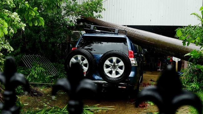 A palm tree smashed a parked SUV in Alawa following Cyclone Marcus's fury over Darwin. Picture: Justin Kennedy
