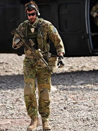 Modern-day Anzac … SAS Corporal Ben Roberts-Smith, VC, MG, leaves a UH-60 Blackhawk helicopter in Afghanistan in 2010. Source: News Limited