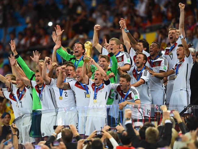 German captain Philipp Lahm holds the World Cup trophy aloft.