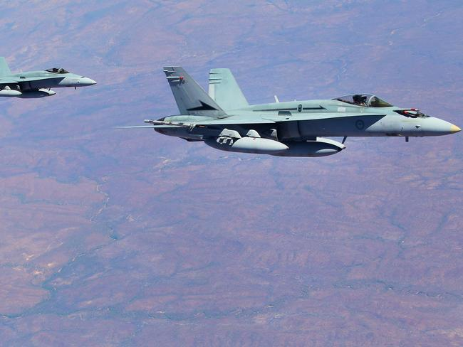 Ready for action ... RAAF FA-18 Hornets during Exercise Pitch Black 27,000 feet over the Northern Territory in August. Pictures: Jack Tran / The Courier Mail