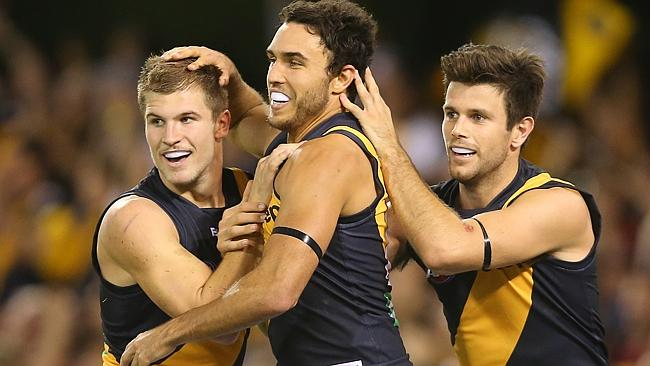 Trent Cotchin (right) celebrates a Shane Edwards goal in the final term with Matt Arnot (left).
