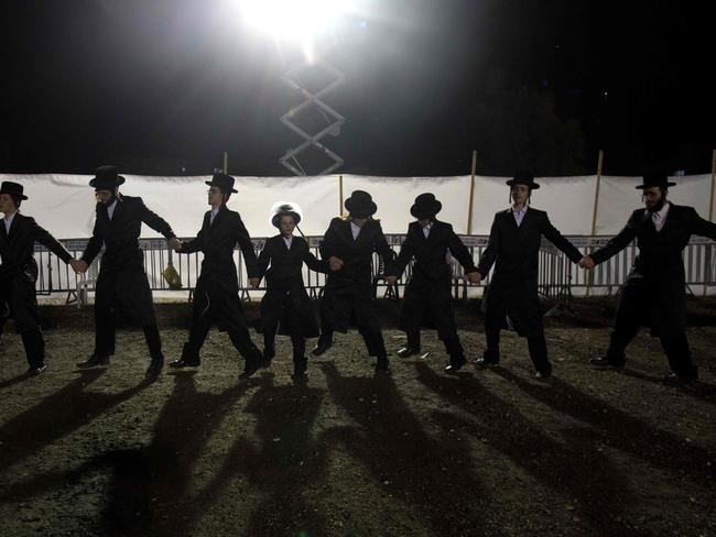 Ultra-Orthodox Jewish Hasidim dance during the wedding ceremony. Picture: AFP/MENAHEM KAHANA