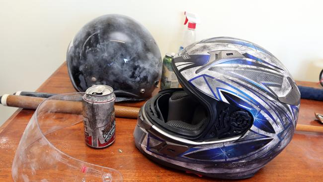These helmets were thrown through the front windows of a neighbouring house. Picture: Richard Gosling