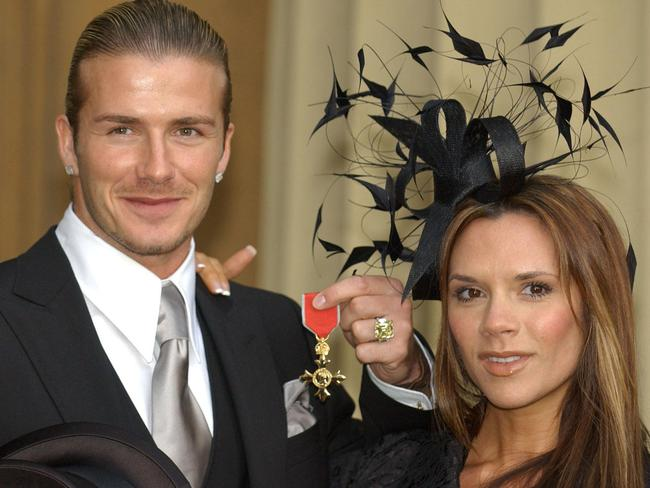 David Beckham received his OBE back in 2003 from Queen Elizabeth II. Picture: Fiona Hanson/AP