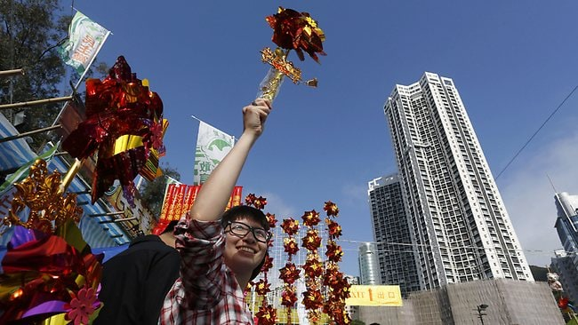 A vendor sells Chinese New Year decorations at a market in Hong Kong's Victoria Park to celebrate the Year of the Snake as the Chinese lunar New Year starts on February 10. (AP Photo/Vincent Yu)