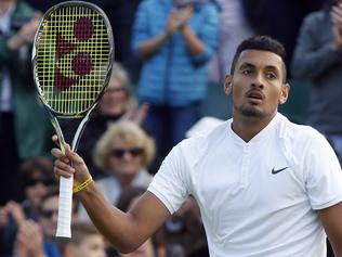 Nick Kyrgios of Australia celebrates beating Dustin Brown of Germany in their men's singles match on day five of the Wimbledon Tennis Championships in London, Friday, July 1, 2016. (AP Photo/Alastair Grant)