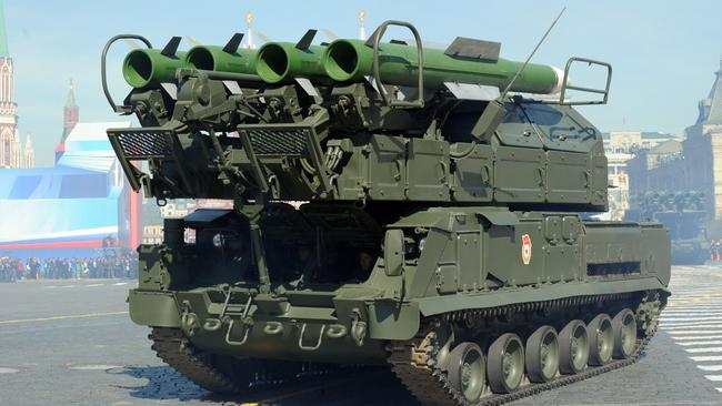 Killing machine ... this file picture shows a Russian Buk-2M armoured launcher vehicle at a Victory Day parade in Moscow.
