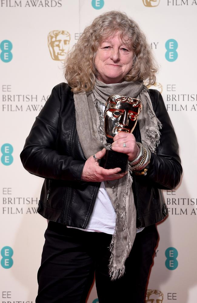 Beavan poses with the Best Costume Design Award for Mad Max: Fury Road.