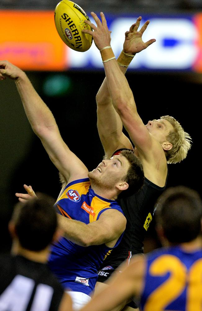 Nick Riewoldt flies against Eagle Jeremy McGovern. Picture: Jay Town