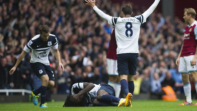 Everton's Bryan Oviedo, centre, reacts as his teammate Romelu Lukaku lays on the ground after scoring the winning goal against West Ham.
