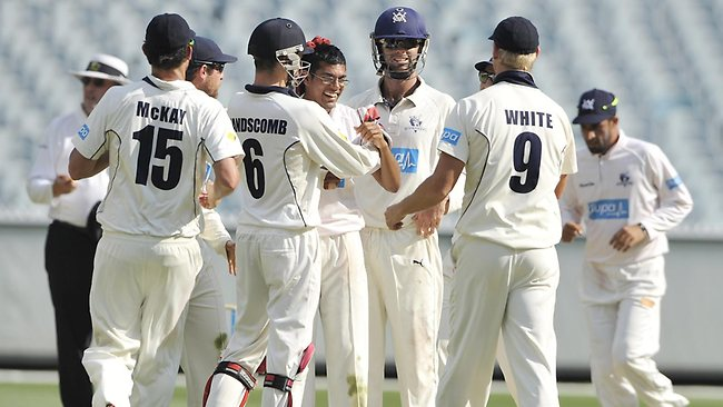Clive Rose is congratulated after bowling the dangerous James Hopes.