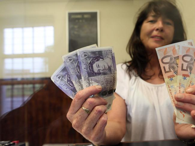 Delia Breen works in a money exchange office between the two countries which could be set to change. Picture: AFP/Paul Faith