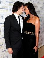<p>Andy Lee and Megan Gale share a private moment at the 2009 Australian Commercial Radio Awards.</p>