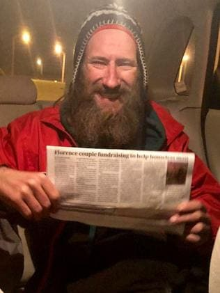 Homeless man Johnny Bobbitt Jr reads the article about him in the paper. Picture: GoFundMe