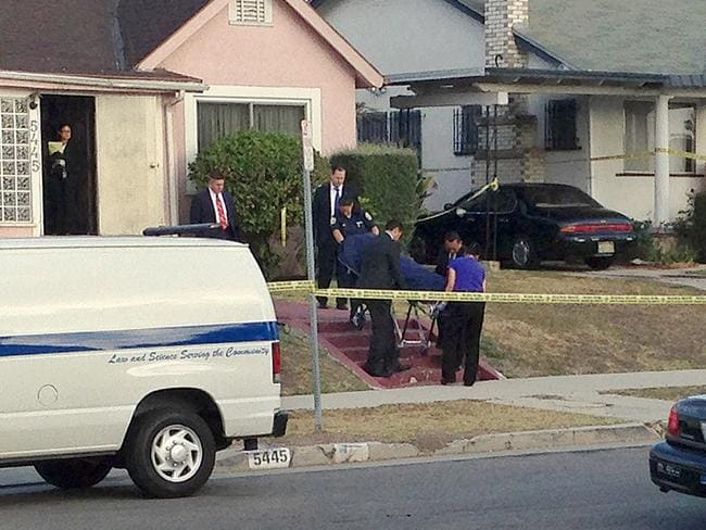 Los Angeles County coroner's officials remove the body of April Jace, the wife of actor Michael Jace, from the couple's home in the Hyde Park area of Los Angeles.